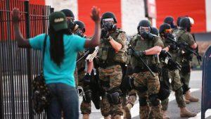 Peaceful protestor in Ferguson, photo credit BBC.com